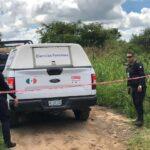 Encuentran el cuerpo de una mujer sin vida, tirada al lado de una carretera.